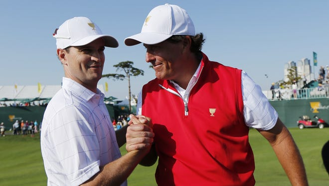 Phil Mickelson, right, and playing partner Zach Johnson won their opening match on Thursday and look to keep up the momentum on Day 2 at the Presidents Cup.