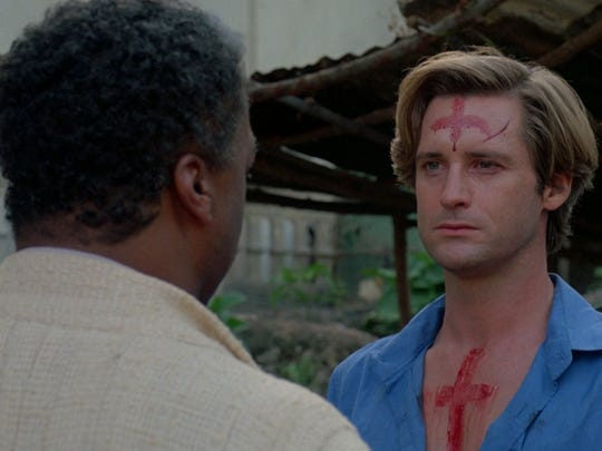 "Paul Winfield (left) and Bill Pullman in a scene from ""The Serpent and the Rainbow."""