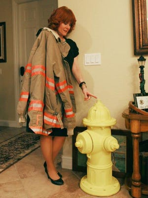Cher LaBruzzo has decorated her home with memories of her husband, Anthony, who was a firefighter and died of cancer after fighting it for three years. This hydrant was given to her by a firefighter who was influenced by her late husband.