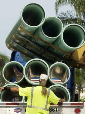 FLORIDA TODAY File - Sewer pipes are installed along South Patrick Drive in 2007