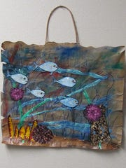 """Fish Bag,"" painting on paper bag by Pat Smith, part of the ""Scandia Family and Friends"" exhibit at Meadows Art Gallery."