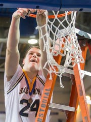 Brian O'Neill cuts off a piece of the net after Salesianum defeated St. Georges to win the 2014 state title. O'Neill was state player of the year in basketball that season.