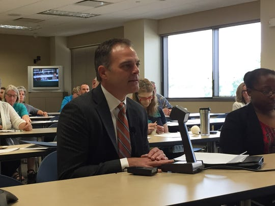 Medica Vice President Geoff Bartsh speaks at an August 2017 hearing about his company's plan to raise health insurance premiums 57 percent to make up for financial losses. The proposal was approved.