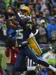 Seattle Seahawks cornerback Richard Sherman intercepts