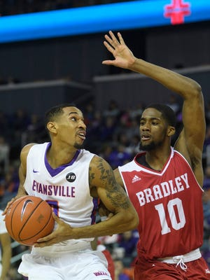 University of Evansville's Ryan Taylor (0) makes his way to the net as Bradley's Elijah Childs (10) guards him during the second half at the Ford Center in Evansville, Ind., Saturday, Jan. 6, 2018. The Purple Aces defeated the Braves, 68-44.