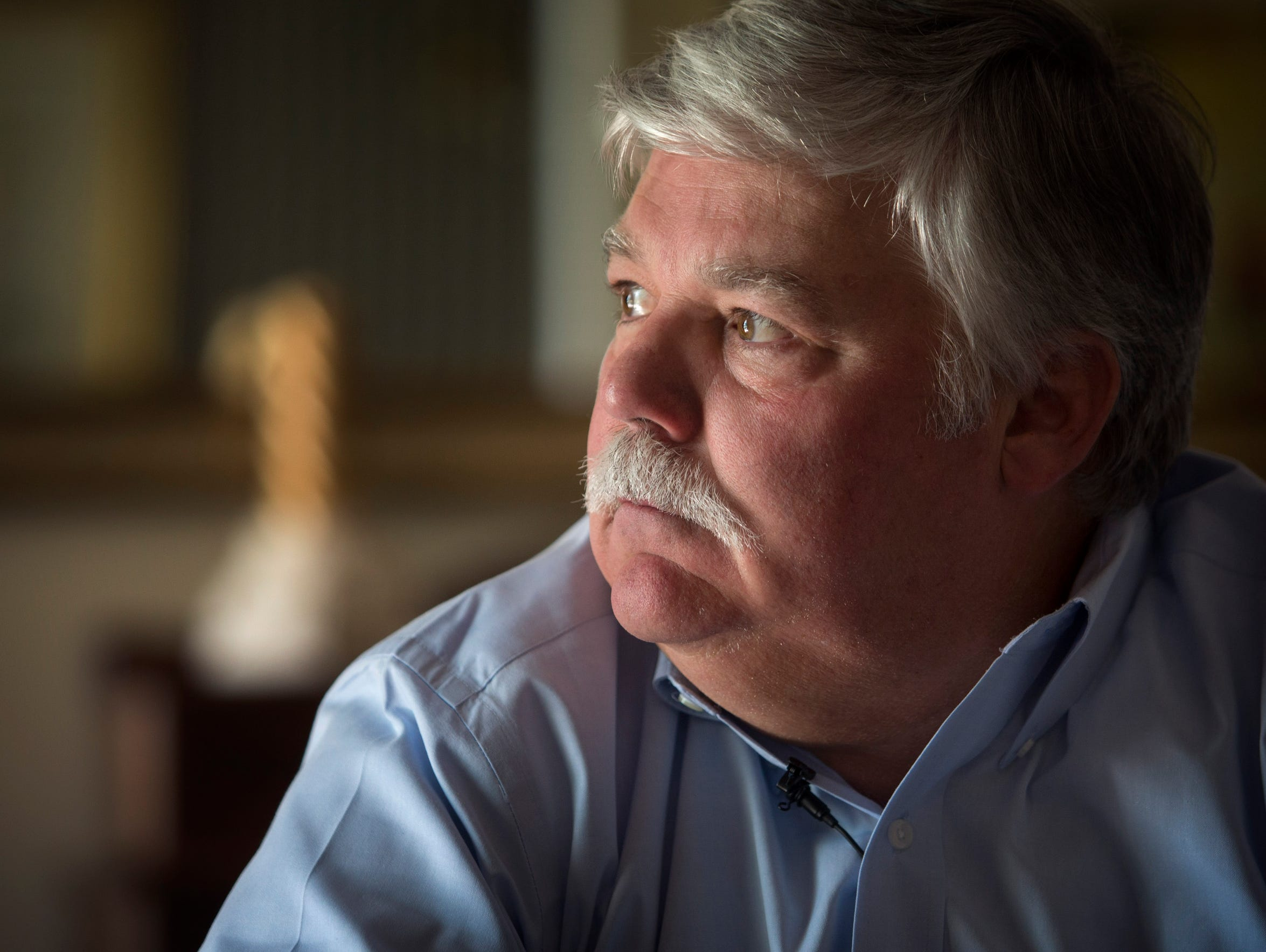 Pat Milam looks out the window of his dining room in
