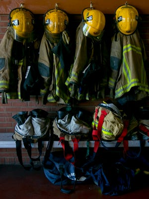 Fire fighters' gear hangs on its posts at Fire Station #7 in Phoenix on April 23, 2013. Pensions for Public Safety Personnel are currently underfunded and have left the state in a troubled situation.