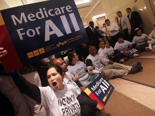 Health Care Activists Conduct Sit In At An Aetna Insurance Office
