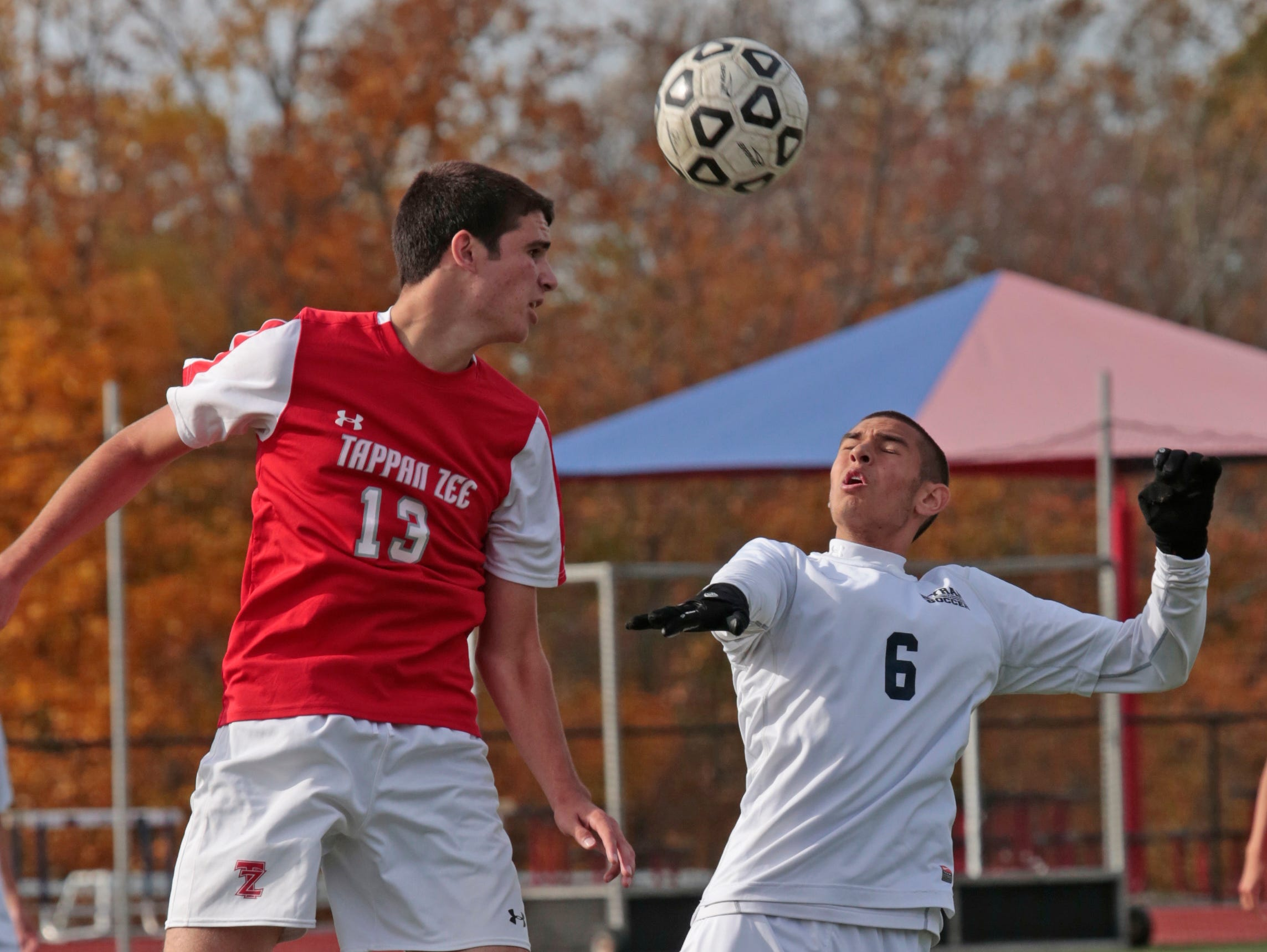 Tappan Zee's Chris Mulqueen (13) and Byrum Hills' Indra Neil Dan (6) battle for control of the ball during the game at Byrum Hills High School in Armonk on Oct. 29, 2015.