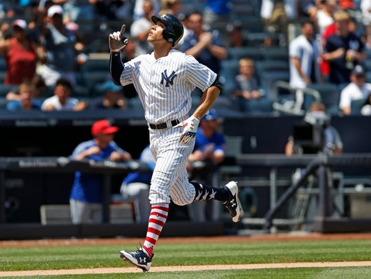 New York Yankees' Aaron Judge gestures after hitting