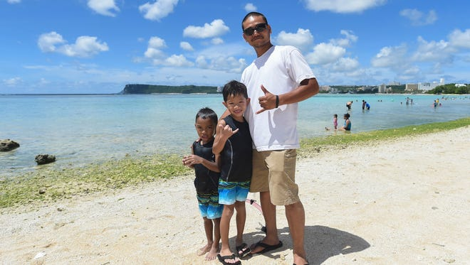 Marco Rios, 34, with his sons Alexander, 7, and Keldy, 5, at the Gov. Joseph Flores Memorial Park in Tumon on June 17, 2018.