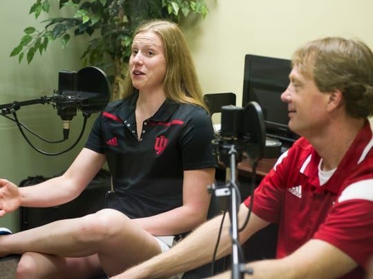 Olympic gold medalist Lilly King, (left) stopped by the Courier & Press Wednesday to talk about her time at the Rio games with Indiana University head swim coach Ray Looze. She even brought along her gold medals.