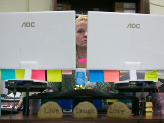 Customer Service Specialist Sonya Nicholson works at her desk at Metro Merchant Services in Delaware City.
