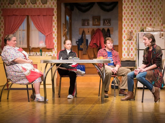 """Raeleen McMillion (from left), Greta Wohlrabe, Josh Krause and Kat Wodtke hold a family meeting in Milwaukee Chamber Theatre's production of """"Miracle on South Division Street."""""""