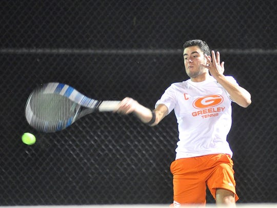 Horace Greeley's Dylan Glickman hits a forehand during