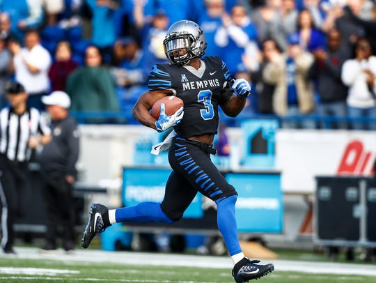 Memphis receiver Anthony Miller ( left) scrambles past