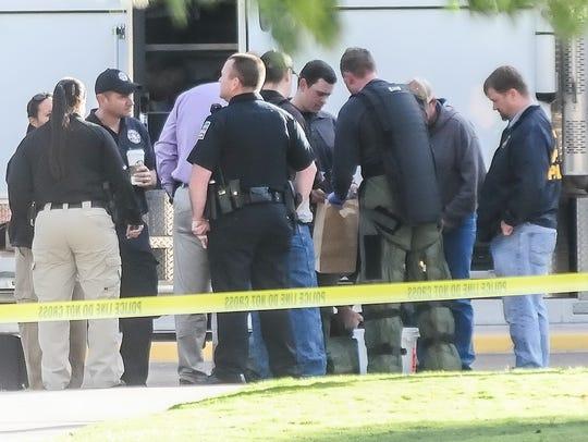 Law enforcement agencies investigate a suspicious package
