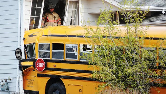 A bus crashed into two southwestern Sioux Falls homes Tuesday morning. The bus driver was injured, but there were no children in the bus at the time of the crash.