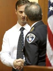 Franklin Police Chief Rick Oliva presents a Citizen
