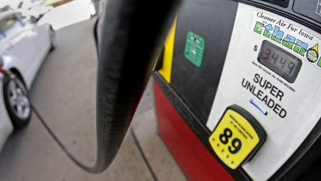 A motorist fills up with gasoline containing ethanol in Des Moines in 2013.