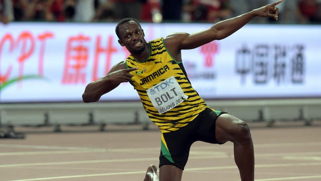 Usain Bolt (JAM) poses after winning the 200m in 19.55 during the IAAF World Championships in Athletics at National Stadium.