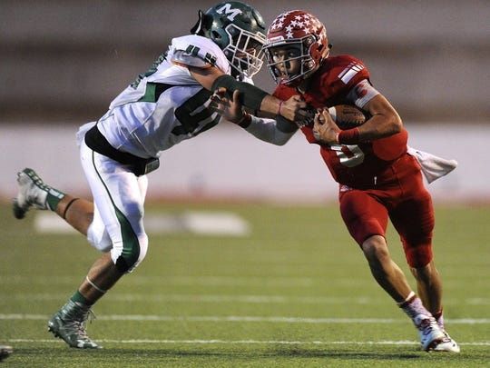 Thomas Metthe/Reporter-News Sweetwater quarterback Chris Thompson (6) tries to shake off Monahans linebacker Seth Hogan (44) during the first quarter of Sweetwater's 19-16 loss on Friday, Oct. 28, 2016, at the Mustang Bowl in Sweetwater.