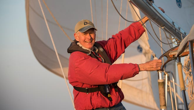 Bud Menchey sails Acadia in the Chesapeake Bay. The sailboat is his obsession, and he has spent the better part of two decades keeping it up.