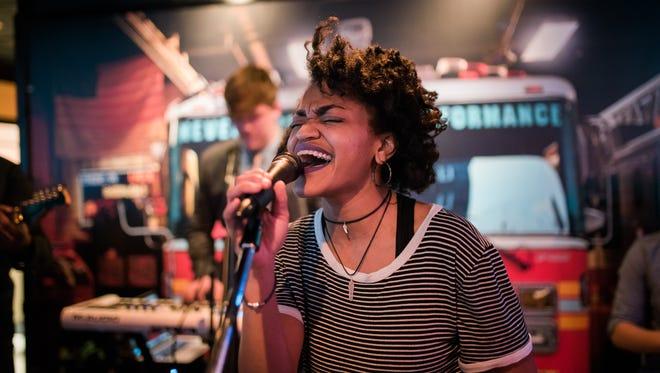 Hoochi Coochi frontwoman  Danielle Johnson performs at Wilmington's Halligan Bar last weekend.