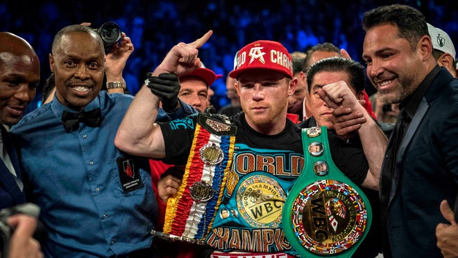 Canelo Alvarez poses for a photo after defeating Amir Khan during their middleweight boxing title fight at T-Mobile Arena.
