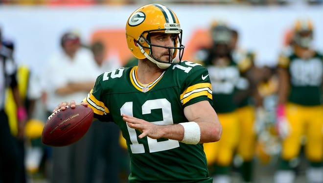 Green Bay Packers quarterback Aaron Rodgers (12) throws a pass against the Miami Dolphins during the first half at Sun Life Stadium.