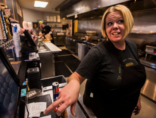 In this file photo, an employee is shown working at Archie's Grill in Shelburne. Employment in Vermont's restaurant sector has dipped in recent months.
