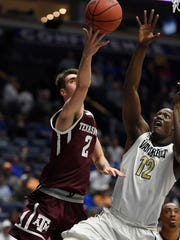 Former Texas A&M forward Eric Vila (2) goes to the basket over Vanderbilt Commodores center Djery Baptiste (12) in the first half of their game in the 2017 SEC Men's Basketball Tournament at Bridgestone Arena on Thursday, March 9, 2017 in Nashville, Tenn. Vila will play for UTEP next season.