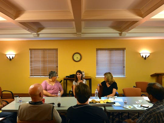 Suzie Bevilacqua, back center, facilitates the weekly meeting of a Brain Injury Center of Ventura County support group held Wednesday nights in Camarillo.