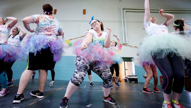 Elmira College sophomore Julie Salinero, of Albany, freestyles on stage during the college's inaugural dance marathon at St. Anthony's Community Center in Elmira Saturday.