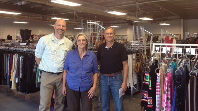 Tres Scheibe, Julie Spotswood and Dick Gygi show off the ThriftSmart store in Franklin in 2014.