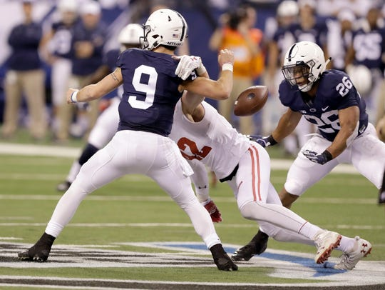 Trace McSorley (9) was beaten but not broken by the