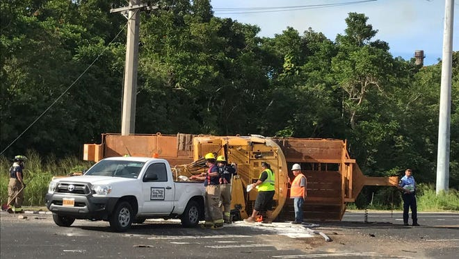Two lanes near Guam Veterans Cemetery were closed briefly this afternoon after a flatbed trailer carrying an excavator overturned, according to Guam Police Department scanners.