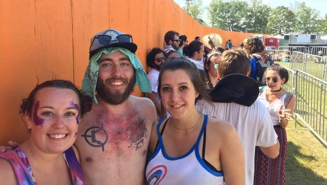 Nicole Flocco (left), Foster Gorman and Hendley Landers, got in line to see the Red Hot Chili Peppers at 11:30 a.m. Saturday - nearly 12 hours before the show was scheduled to begin.