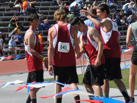 The Corona Cardinal track team celebrates its come-from-behind