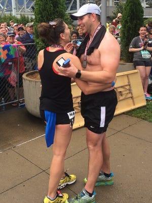 Sarah Stender, 30, and Matt Weber, 29, celebrate their engagement at the finish line of the Nashville St. Jude Rock 'n' Roll Marathon.