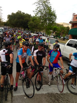 Road cycling enthusiasts prepare to embark on the Intracoastal Waterway Century Ride, a long-distance cycling event hosted by the Space Coast Freewheelers.