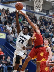 Tamaje' Blackwell of Reitz is fouled by Sam Fulton of Mater Dei while attempting a layup during the second quarter of the game at Reitz in Evansville Friday.