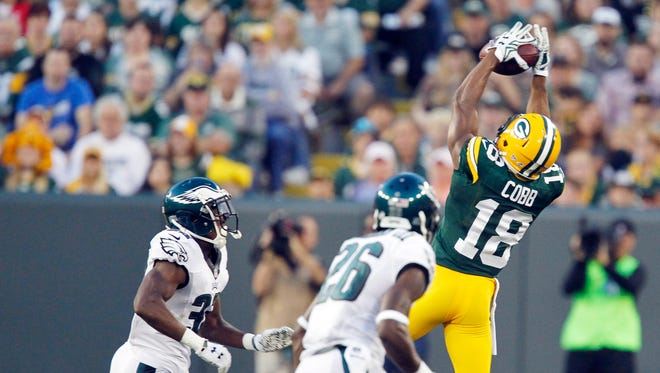 Packers receiver Randall Cobb goes up for a pass during the first half against the Philadelphia Eagles. Cobb injured his shoulder on the play.