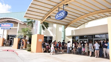 Shoppers stream into the Ross entrance of Guam Premier Outlets in Tamuning in this 2014 file photo.