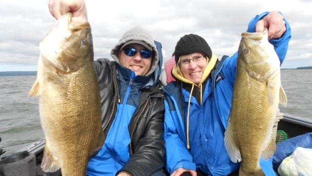 Tom Anderson, Jr. and his mother Mary Anderson of Minnesota joined guide Jeff Evans on Chequamegon Bay in September 2014.