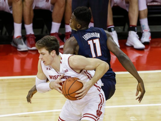 Wisconsin's Ethan Happ (22) steals a pass from Illinois' Greg Eboigbodin (11) during the first half of an NCAA college basketball game Friday, Jan. 19, 2018, in Madison, Wis. (AP Photo/Andy Manis)