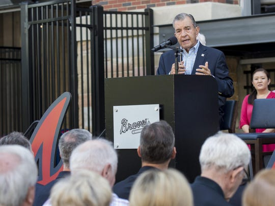John Schuerholz speaks during the unveiling of the