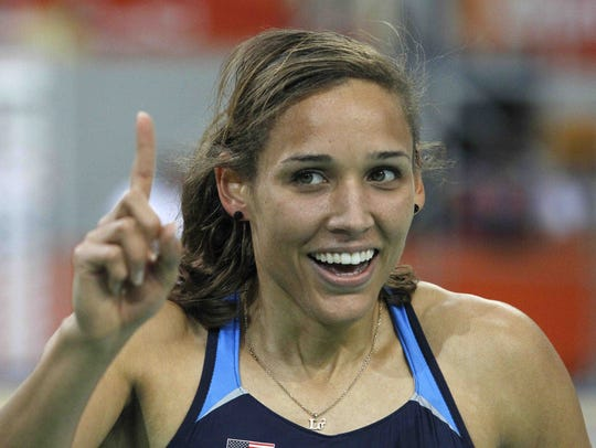 LoLo Jones of the United States celebrates after winning