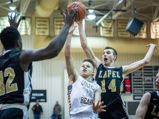 Monroe Central's Israel Nash shoots past Lapel's defense