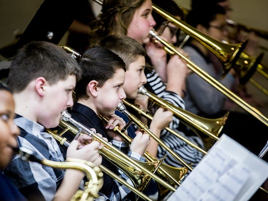 Inspire Academy's band performs for attendees during exhibition night Wednesday evening.